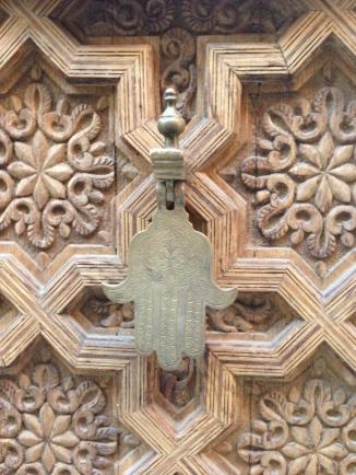 medina door with lucky hand