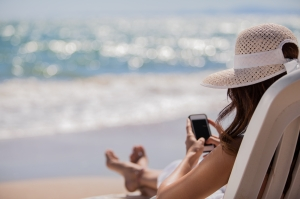 checking email on beach