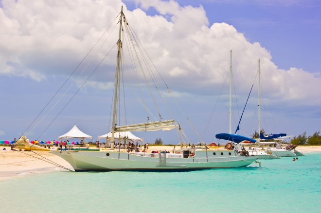 Boats at Turks and Caicos deserted beach