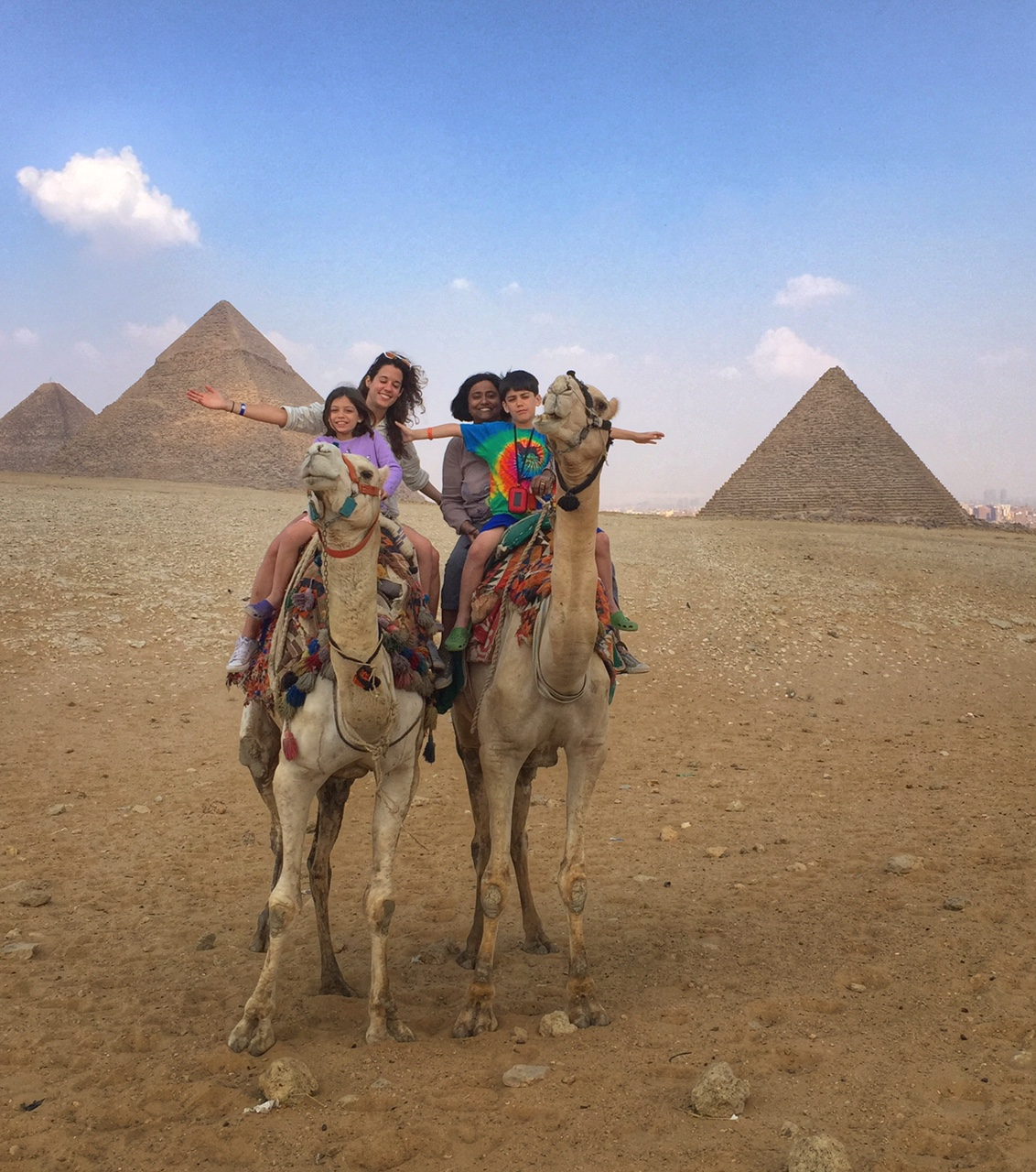 family photo in front of pyramids