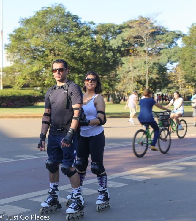 roller blading couple at Ibirapuera Park Sao Paulo Brasil